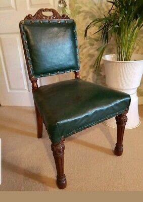 A pair of Antique Green Leather Dining Chairs