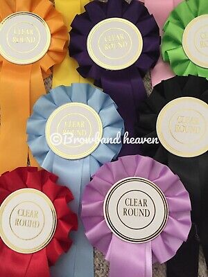 100 Clear Round Rosettes. Mixed Colours.White 50mm Centres.