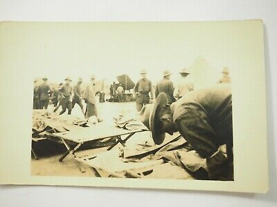 WWI Soldiers Sleeping outside on Cots Real Photo Postcard RPPC