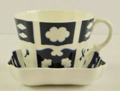 Unusual Vintage White & Blue Cup & saucer set