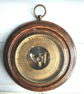 Antique oak barometer with brass face and bevelled glass
