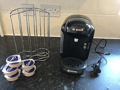 Bosch tassimo coffee machine & Pod Holder. Also Comes With 5 Hot Chocolate Pods