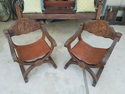 Pair of beautiful antique carved wood Savonarola chairs with leather seats