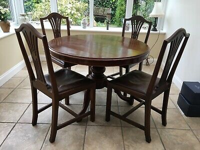 Antique Mahogony table. Good condition 104cm tilt top good condition x 6 chairs