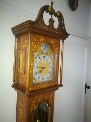 A superb inlaid and marquetry longcase clock.