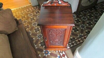 An Edwardian Mahogany Pot Cupboard Bedside Cabinet Side Table with carved detail
