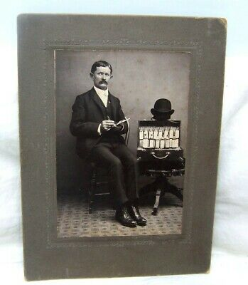 1900's White Hall Illinois Traveling Medicine Salesman w/ Elixir Bottles Photo