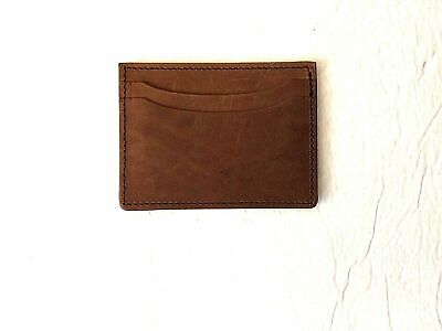 Genuine Brown  leather double sided card case made in the USA.