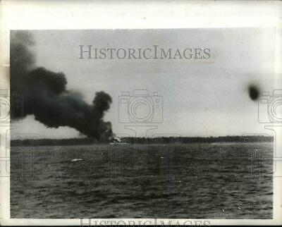 1942 Press Photo Smoke and flames from the Japanese owned Airstrip