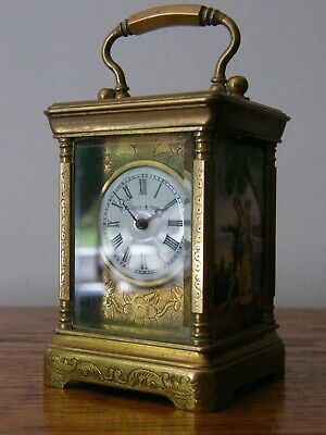 A  Miniature Elliott & Son French Movement Brass Enamel Panel Carriage Clock