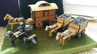 5 Pieces Of Antique Straw And Bog Oak Folk Art Mules And Carts