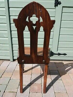 Dark Wood gothic style chair.