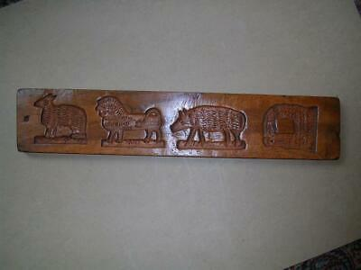 Antique 19th century walnut double sided gingerbread mould. 20.5 inches. Treen