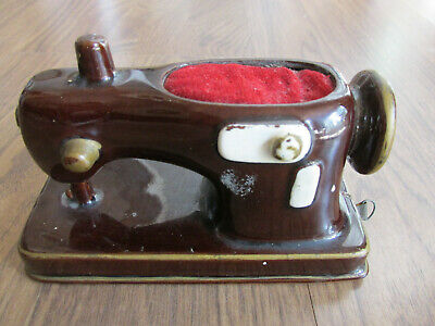Vintage 1950's  Sewing Measuring Tape With Pin Cushion on Top of Sewing Machine