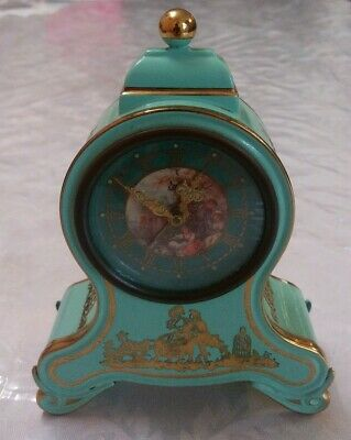 Antique Enemalet Table Clock With Alarm And Music, good working conditions.