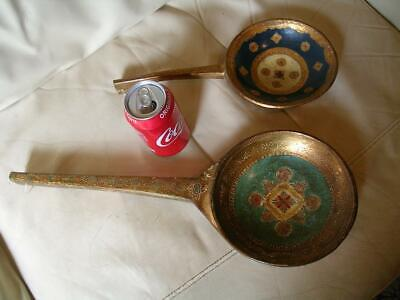 Two large antique painted and gilded ladles.