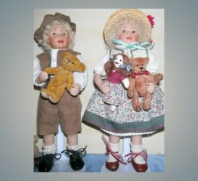 Artist Porcelain doll pair boy and girl with their teddy bears and fabric doll