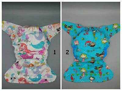 SassyCloth one size pocket cloth diaper with mermaids cotton print.