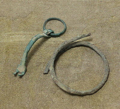 RARE ANCIENT ROMAN BRONZE D-SHAPED FIBULA AND BRACELET CIRCA 1st-3rd CENTURY AD.