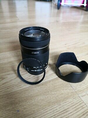 Canon ef-s 18-135mm f/3.5-5.6  with protective lens and hood. In mint condition