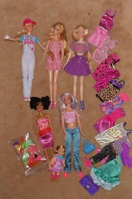 Bulk Barbie dolls with lots of new clothes and shoes Bag Z 07