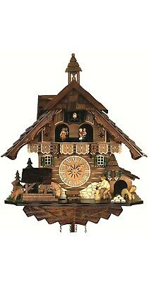 Quartz Cuckoo Clock Black Forest house with moving wood chopper.. EN 483 QMT NEW