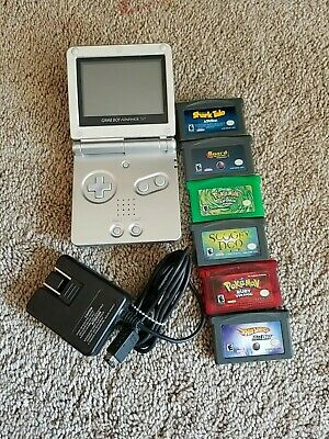 Nintendo Game Boy Advance SP Silver Handheld System  AGS-001 with 6 games.