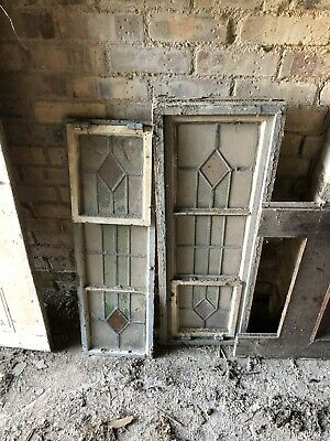 Stained glass windows still in wooden frames.