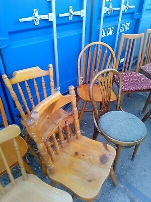 Used wooden chairs assorted in used condition. 20 chairs and 3 bar stools