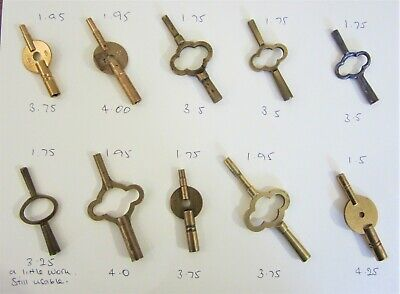 Ten excellent traditional Carriage Clock double ended keys. Brass and one steel.