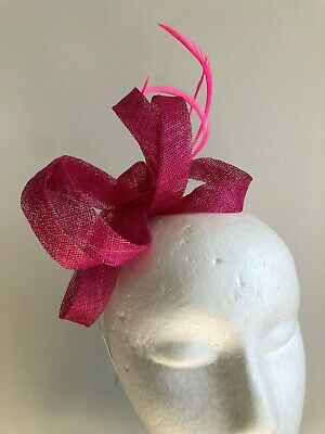 Gorgeous pink sinamay loop fascinator with feathers on a metal headband!