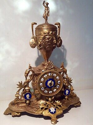 Unusual style Tall 19th C. French gilded figural chiming mantle clock
