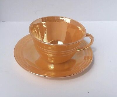 Fire king oven ware collectible antique cup and saucer Peach Lustre Three Ring.