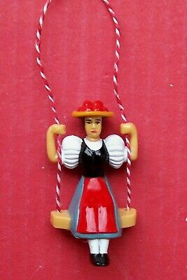 Pendulum,  swinging German girl for a small novelty type cuckoo clock.