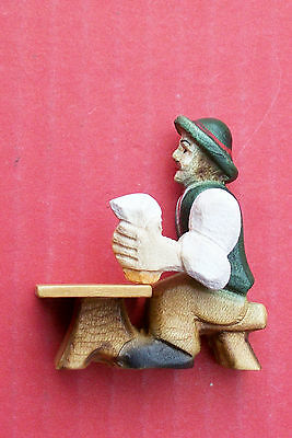 Hand carved seated German beer drinker with moving arm,   for RH side fixing.