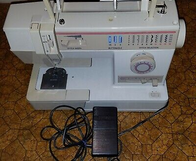 Singer sewing machine 9410 with Pedal & Cloth Cover