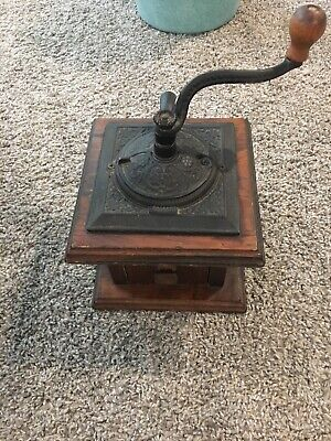 Vintage Coffee Grinder with Ornate Cast Iron Top