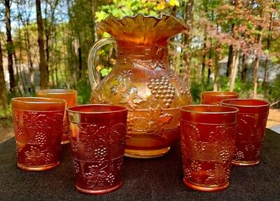 Antique DUGAN GRAPES AND FLORAL MARIGOLD CARNIVAL GLASS PITCHER & 8-TUMBLERS