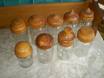 9  assorted vintage glass jars with assorted  turned australian timber tops