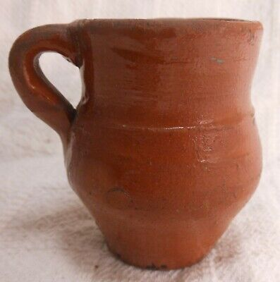 Great Early American Miniature Redware Mug, Creamer With Applied Handle