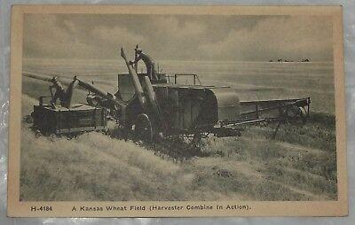 h-4184 a kansas wheat field (harvester combine in action) rare