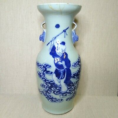 Antique Chinese blue and white porcelain vase, 19th century. There is a lamp.
