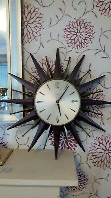Metamec sunburst starburst teak and brass clock as found