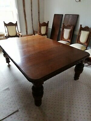 Late 19th Century Carved Oak extending dining table