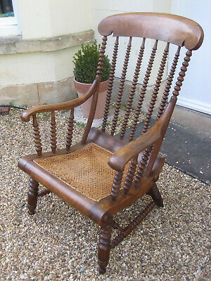 19th century Lathe Back Elbow Chair with Intricate Bobbin Supports Cane Seat *
