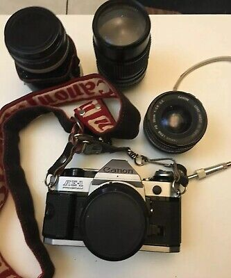 Canon AE-1 Program 35mm SLR Film Camera with 50mm f/1.8 Lens For Parts Or Repair