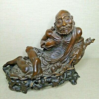 Antique Chinese wooden figurine, 19th century. The object has a wooden base.