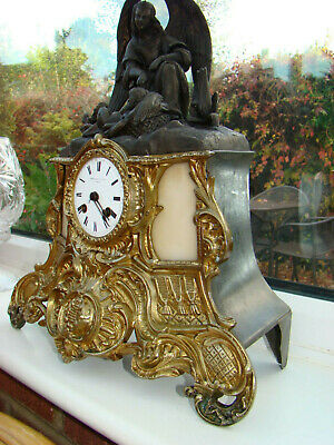French mantel clock 8 day strike on bell brass front & bronze look top angel