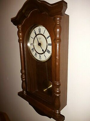 Hermle Wooden Wall Clock, Battery Operate Dark Brown With Pendulum & Chimes
