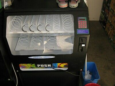 SNACK VENDING MACHINE    multi priced non change giving reliable